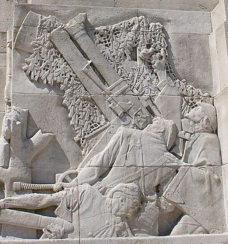 Royal Artillery Memorial - Part of the memorial's carved reliefs, showing gunners operating a trench howitzer