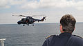 Royal Netherlands Navy Lt. Cmdr. Boudewijn Boots, the commanding officer of the frigate HNLMS Evertsen (F805), watches from the ship's bridge as a Danish military helicopter flies alongside June 12, 2013 130612-N-ZZ999-043.jpg