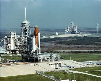 STS-41 - 20 September 1990 – Rare view of two Space Shuttles (STS-35 and STS-41) on adjacent KSC Launch Complex 39 pads. Discovery is on LC-39B in the background, Columbia is on LC-39A in the foreground.