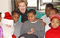 SENATOR ELIZABETH DOLE WITH SANTA AND CHILDREN AT OFFICE HOLIDAY PARTY.jpg