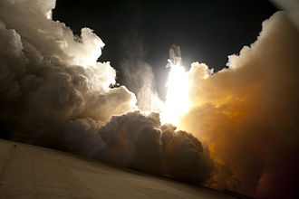 Solid-propellant rocket - An exhaust cloud engulfs Launch Pad 39A at NASA's Kennedy Space Centre in Florida as the space shuttle ''Endeavour'' lifts off.