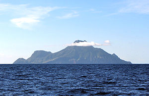 Saba - Saba island as viewed from the north, with Mount Scenery's peak in the clouds.
