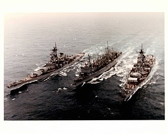 USS Sacramento (AOE-1) - Sacramento (AOE-1) simultaneous UNREP with Wisconsin (BB-64) (foreground) and Missouri (BB-63) during Operation Desert Shield, January 1991.