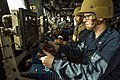 Sailors monitor contacts through a MK38 25mm gun system. (12662947963).jpg