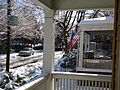 Scene from porch winter in Summit NJ with flag and snow.JPG
