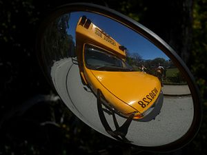 Photograph of a school bus cross-view mirror A...
