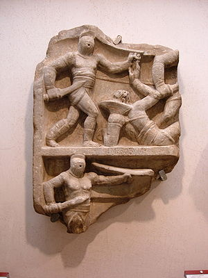 Samnite (gladiator type) - The secutor, as seen on the left in this relief, was one of the heavily armed gladiators who succeeded the Samnite.
