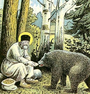 Seraphim of Sarov - Saint Seraphim feeding a bear outside of his hermitage (from lithograph The Way to Sarov, 1903).