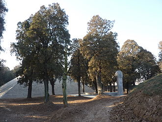 "Shaohao Tomb - The tomb (the earthen tumulus) (right) is seen with the stele inscribed ""Shao Hao Ling"" (""Shaohao Tomb"") between it and the Shou Qiu (the pyramid) (left)."
