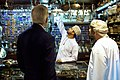 Shopkeeper Points to Wares as Secretary Kerry Pays Visit to Muttrah Souk in Oman.jpg