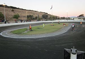"""Sidewinders Speedway - Sidewinders U/16 Speedway in 2011 showing """"Mt. Wingfield"""" to the left and the clubrooms at the top right"""