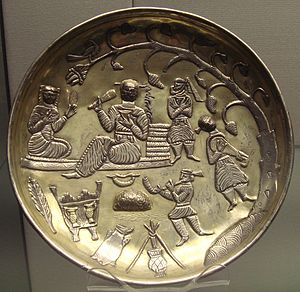 Amol - Silver gilt dish of Tapuria, 7th–8th centuries. A tradition initiated under the Sasanians and continued after the Arab invasions. Anuzhad inscription in Pahlavi script, next to the reclining figure. British Museum