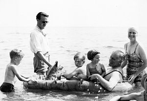 Willoughby Norrie, 1st Baron Norrie - Norrie (in dinghy) and his family, with Captain Farebrother, ADC (standing, left) at Henley Beach, South Australia, December 1946
