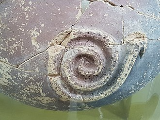 Serpent (symbolism) - Snake decoration on Bronze Age pot from Rumailah, Al Ain