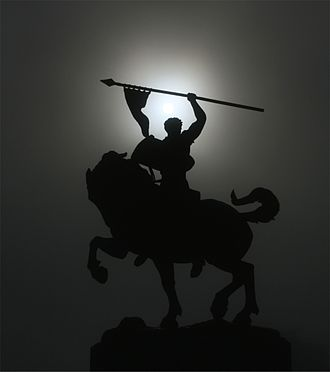 Legion of Honor (museum) - Statue of El Cid silhouetted by a solar corona in front of the Legion.