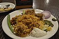 Southindian spicy briyani with Side dish.JPG