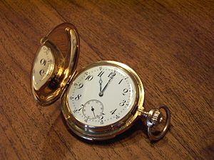 Clockface of an old spring-cover clock