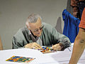 Stan Lee signs for fans (5134638728).jpg