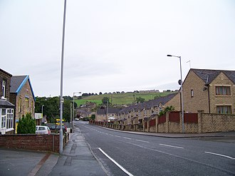 Clayton, West Yorkshire - Station Road, Clayton showing the steep valley sides with Clayton Heights at the top of hill.