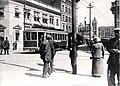 Streetcar and pedestrians, 11th Avenue, 1911.jpg