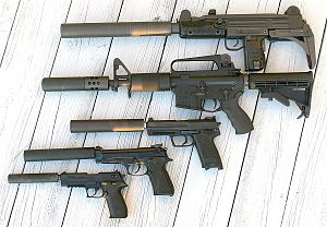 Suppressor - Several firearms with detachable suppressors, from top to bottom: an Uzi, an AR-15, a Heckler & Koch USP Tactical, a Beretta 92FS, and a SIG Mosquito