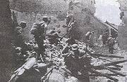 Chinese soldiers in house-to-house fighting in Battle of Tai'erzhuang.