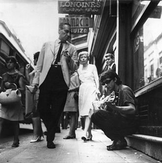Tanguito - Tanguito playing guitar on the street, 1968.