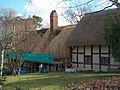 Thatching on England's most famous thatched cottage - geograph.org.uk - 1611379.jpg