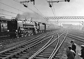 BR Standard Class 7 70013 Oliver Cromwell - The Down 'Broadsman' pulled by 70013 passes through Stratford in April 1958