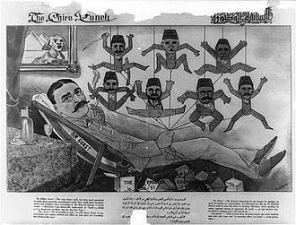 Eldon Gorst - Political cartoon published in the Cairo Punch, showing Sir Eldon Gorst, reclining and holding strings attached to puppets representing Egyptian ministers