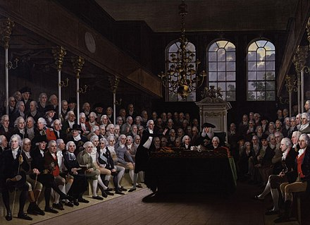 William Pitt the Younger addressing the House of Commons. Pitt's 19 years as Prime Minister followed by Lord Liverpool's 15, led the Tory Party to accept the office as a convention of the constitution. William Pitt the Younger at Westminster.gif