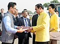 The Minister of State for Home Affairs, Shri Kiren Rijiju presenting a photo album to the Prime Minister of the Kingdom of Thailand, General Prayut Chan-o-cha, in New Delhi.jpg