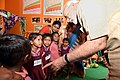 The Prime Minister, Shri Narendra Modi interacting with the beneficiary children of Poshan Abhiyan, at the Model Anganwadi Centre, at Jangla, in Bijapur, Chhattisgarh on April 14, 2018.jpg