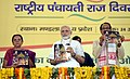 The Prime Minister, Shri Narendra Modi unveiling a Road Map for overall development of tribals during the next five years, on the occasion of the National Panchayati Raj Day 2018, at Mandla, Madhya Pradesh.JPG