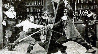 Charles Belcher (actor) - Douglas Fairbanks fighting Charles Belcher in The Three Musketeers (1921