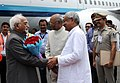 The Vice President, Shri M. Hamid Ansari being received by the Governor of Bihar, Shri Ram Nath Kovind and the Chief Minister of Bihar, Shri Nitish Kumar, on his arrival, in Patna on June 24, 2016 (1).jpg