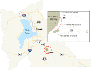 Map showing an area of Utah County circled and enlarged to the southeast of Utah Lake. The enlarged area shows an abandoned rail and highway grades to the west and south of replacement rail and highway grades.