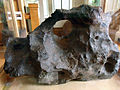 Thumper of a Canyon Diablo meteorite with hole (12419204905).jpg
