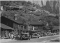 Tourists leaving Zion Lodge for the Temple of Sinawava and trail trip to Narrows. - NARA - 520535.tif