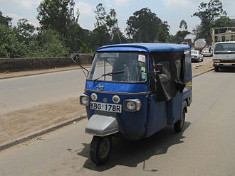 Vehicle registration plates of Kenya - An auto rickshaw with the current Kenyan license plate in Nairobi