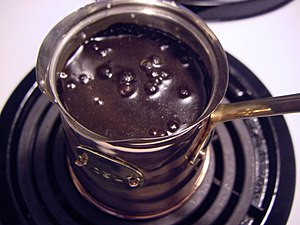 Decoction - Turkish coffee beginning to boil. Decoction compares to brewing coffee through percolation.