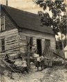Two children stand in front of a house, Ontario, 03Q P907P50.tiff