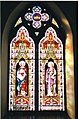 Two stained glass windows in St. Mark's Anglican Church, Deseronto, Ontario, taken on the day of the church's deconsecration in December 2001. The windows depict two saints (one St. Mark?). In the (3684521156).jpg