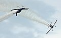 Two stunt planes having fun at Arctic Thunder (4851393097).jpg