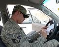 U.S. Air Force Staff Sgt. Dustin Roberts, a 379th Air Expeditionary Wing Public Affairs broadcaster, signs an Air Force Form 1800 at Al Udeid Air Base, Qatar, Jan. 10, 2014 140110-Z-QD538-003.jpg