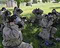 U.S. Air Force personnel with the 15th Operational Weather Squadron (OWS) put on their gas masks during a class on chemical warfare at Scott Air Force Base, Ill., June 12, 2008 080612-F-AV193-062.jpg