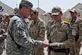 U.S. Army Brig. Gen. Theodore Johnson, left, commander of Task Force Rushmore, presents a Bulgarian soldier with an award during a change of command ceremony Sept 100901-A-GY802-014.jpg