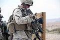 U.S. Marine Corps Pfc. Ryan Carmona, a rifleman, with company K, 3rd Battalion, 7th Marine Regiment unloads M32 grenade launcher during small unit leadership training on range 106 held at Marine Air Ground 130611-M-KL428-064.jpg