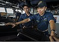 U.S. Navy Ensigns Anand Jantzen, right, and Patrick Yu stand watch in the pilot house aboard the guided missile destroyer USS Mustin (DDG 89) Nov. 4, 2013, in the South China Sea 131104-N-CG241-044.jpg
