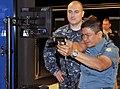 U.S. Navy Gunner's Mate 1st Class David Stevens, left, a facilitator with the USS Missouri Small Arms Marksmanship Trainer (SAMT), observes Indonesian navy Lt. Cmdr. Burhannanda Inggil Pibadhi, assigned to the 121001-N-IK959-705.jpg